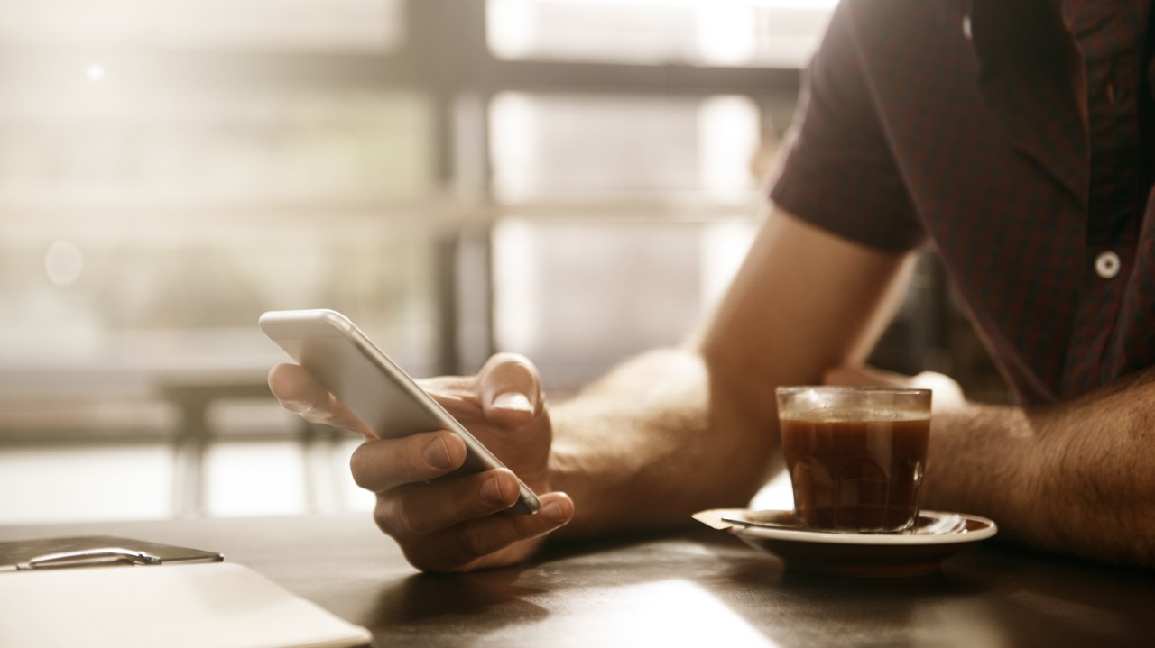 Cropped shot of a man sending a text message on his cellphone at a cafehttp://195.154.178.81/DATA/istock_collage/a5/shoots/785349.jpg