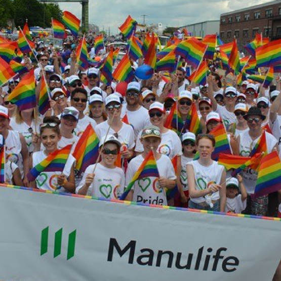 Manulife Halifax employees march with rainbow flags and shirts for the PRIDE parade.