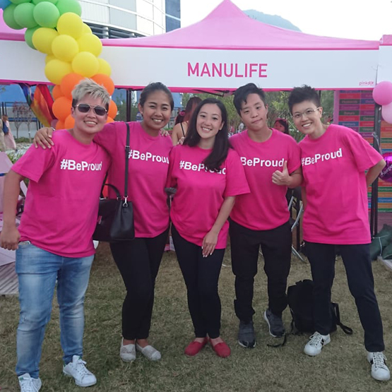 PROUD members representing Manulife at an outdoor event Manulife booth.